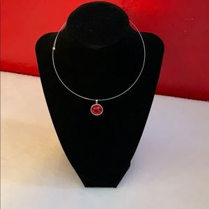 Silver circle necklace with red stone
